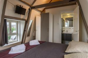 A bed or beds in a room at Great Location in City Center Amsterdam