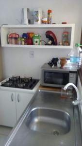 A kitchen or kitchenette at Residencial Joan