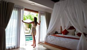 A bed or beds in a room at Jivana Resort