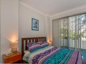 A bed or beds in a room at Ocean Palms 1