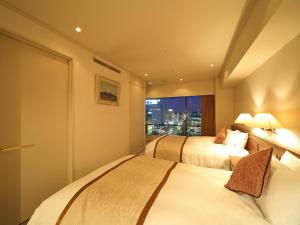A bed or beds in a room at Hotel Harvest In Yonago