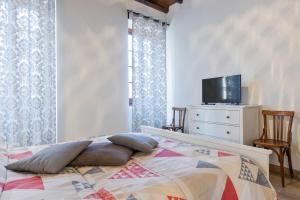 Cama o camas de una habitación en Urbana 37