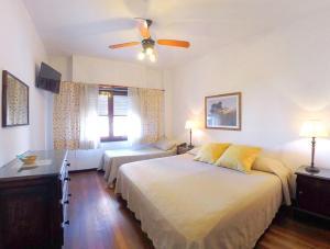 Una cama o camas en una habitación de Hotel Imperio