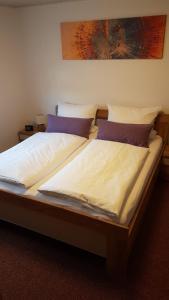 Кровать или кровати в номере Ferienhaus Günther