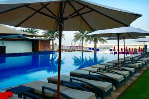 The swimming pool at or near Stunning 5* 4BR-Oceanfront-Apartment