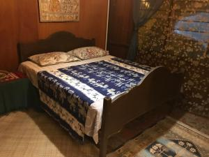 A bed or beds in a room at Rumah Tiang 16