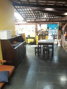 Un restaurante o sitio para comer en Casa da Lapa