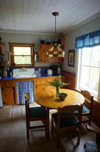A kitchen or kitchenette at Maggie's Place on the Cabot Trail