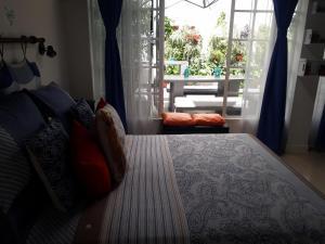 Una cama o camas en una habitación de La Casita De Las Superguias