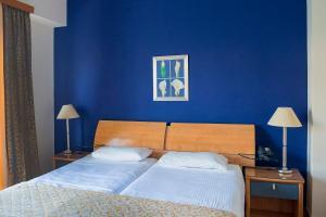 Ένα ή περισσότερα κρεβάτια σε δωμάτιο στο Lucy Hotel
