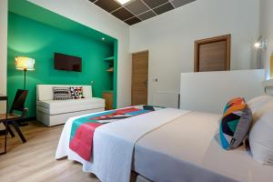 A bed or beds in a room at Colors Ladadika Thessaloniki