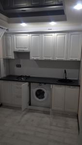 A kitchen or kitchenette at Улица Ленина 58А