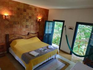 Cama o camas de una habitación en Pousada Villa Bia