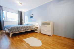 Postel nebo postele na pokoji v ubytování BestVienna U1 Kagran/DZ