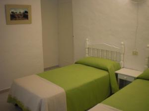 A bed or beds in a room at Agroturisme Binisaid NOU