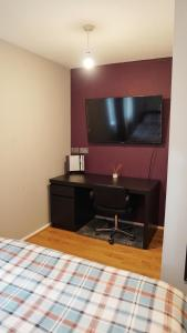 A television and/or entertainment center at North London Apartment - Edmonton