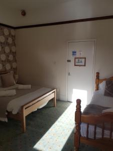A bed or beds in a room at The Waterford Arms