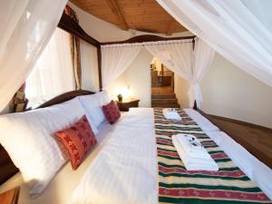 Postel nebo postele na pokoji v ubytování Residence Safari Resort - Chateau