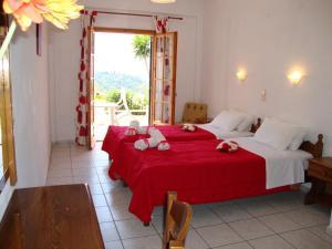 Ένα ή περισσότερα κρεβάτια σε δωμάτιο στο Ipsia Apartments