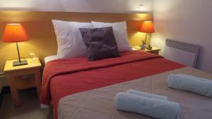 A bed or beds in a room at VVF Villages « Le Parc des Cévennes » Florac