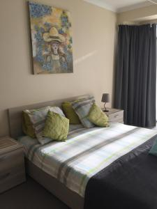 A bed or beds in a room at Residentie Royal Park