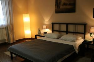 A bed or beds in a room at Wings Hostel