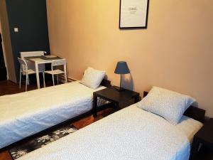 Posteľ alebo postele v izbe v ubytovaní Libroom