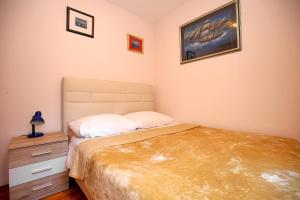 A bed or beds in a room at Julijana