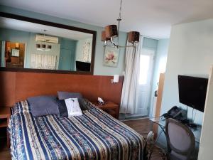 Un ou plusieurs lits dans un hébergement de l'établissement Auberge Maison Roy