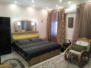 Кровать или кровати в номере Апартаменты на Советов 62