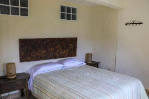 A bed or beds in a room at Villas KM5