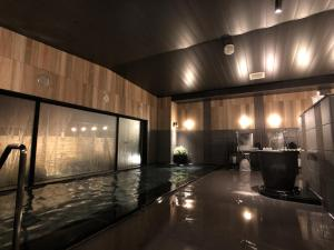 The swimming pool at or near Hotel Route-Inn Koga Ekimae