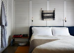 A bed or beds in a room at Ace Hotel and Swim Club Palm Springs