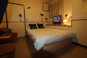 Hotel Yuyukan Center of Kabukicho, Shinjukuにあるベッド
