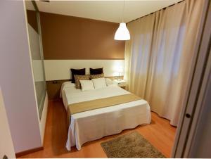Cama o camas de una habitación en Apartaments Casanova Bcn