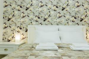 Кровать или кровати в номере Уютная квартира в новом доме недалеко от центра