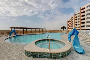 The swimming pool at or close to Jetty East Condos
