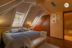 Llit o llits en una habitació de Hotel & Spa Casa Irene