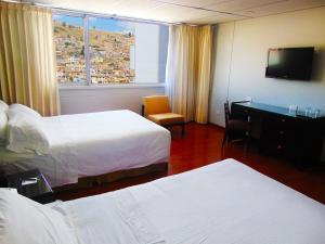 Cama o camas de una habitación en Hotel Hunza y Centro De Convenciones
