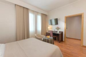 Cama ou camas em um quarto em Hotel Minerva