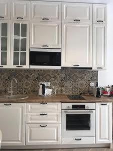 A kitchen or kitchenette at Kurshevel apartments