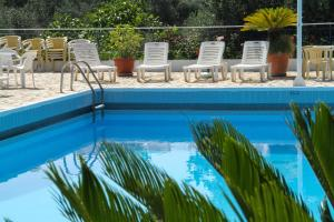 The swimming pool at or near La Calma Hotel
