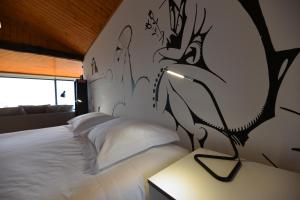 A bed or beds in a room at Mimo House