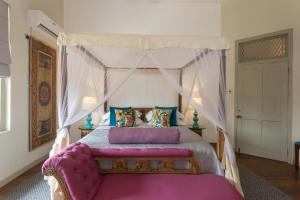 A bed or beds in a room at Prana Home