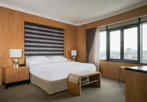 A bed or beds in a room at Sheraton Ankara Hotel & Convention Center
