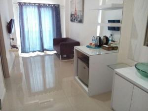 A kitchen or kitchenette at Myrooms Bekasi