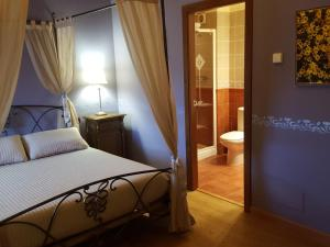 A bed or beds in a room at Hotel Abuelo Rullo