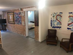 O zonă de relaxare la Appartamento Vicino Al Centro