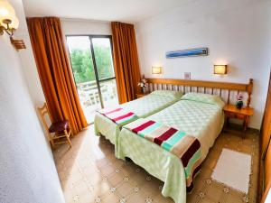 A bed or beds in a room at Bon Aire