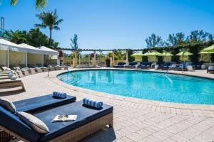 The swimming pool at or near Naples Grande Beach Resort